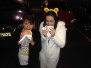 tucking into a tasty burger from kk catering burger van hire manchester