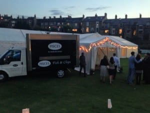 Our Branded fish and chip van outside a summer wedding marquee