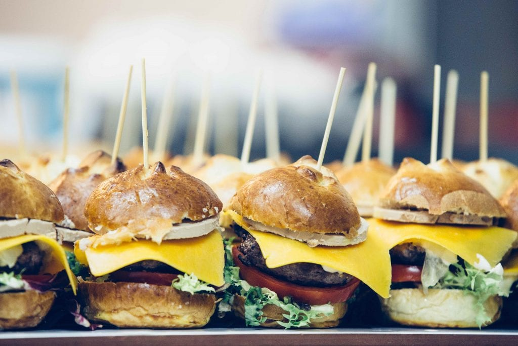 Close up of mini burger with cheese and salad on a delicious bread spanish tapas ready to serve