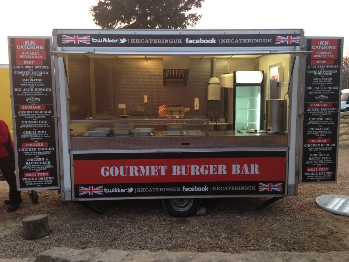 Red and black gourmet burger van set up at event
