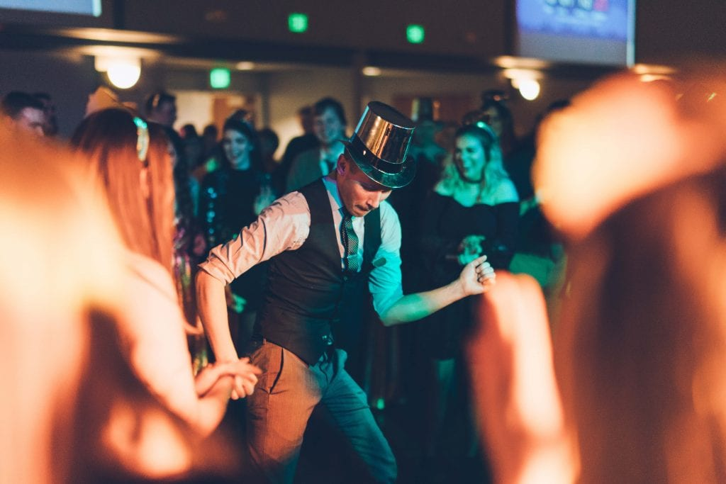 Man Dancing In Top Hat At Wedding Party