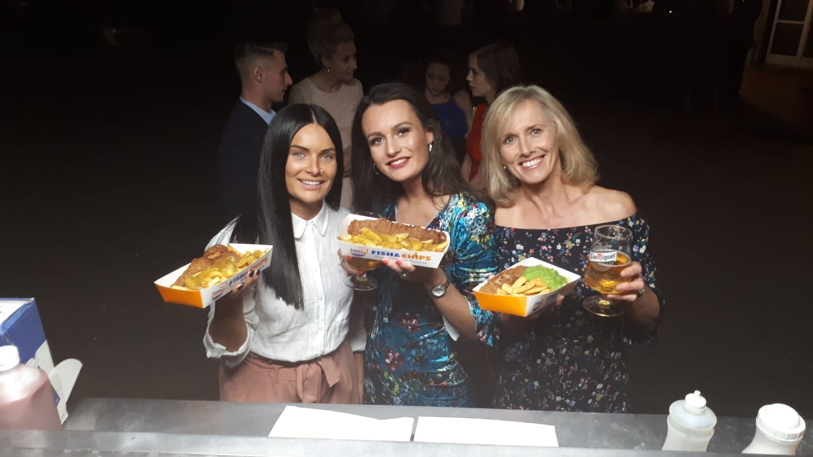 Three ladies with fish and chips