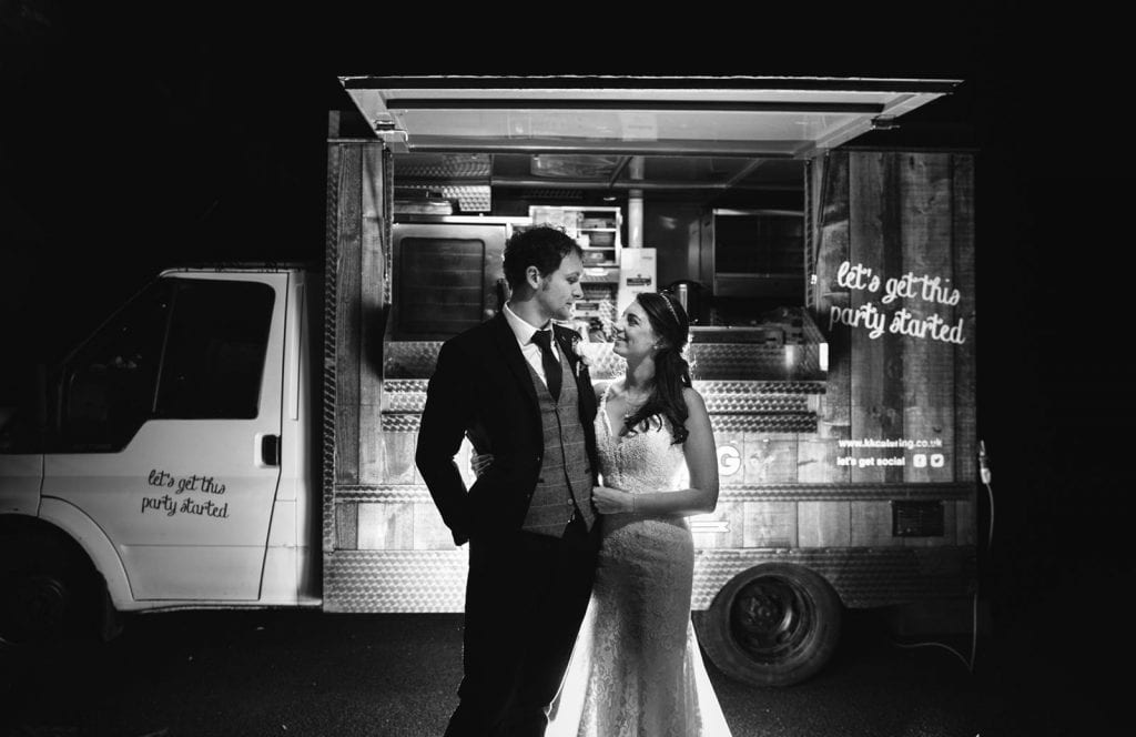 Couple stand in fron of fish and chip van