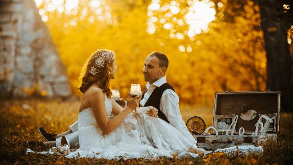 bride and groom sat in woodland