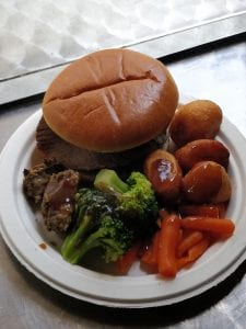 Roast beef sandwich with broccoli carrots roast potatoes and gravy