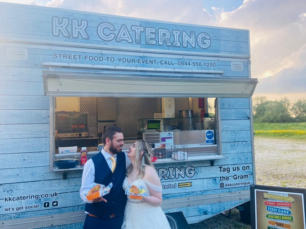 Bride and groom with fish and chips at kk catering fish and chip van